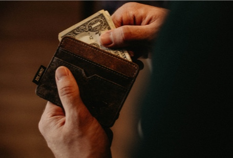 image of a wallet with a one dollar bill